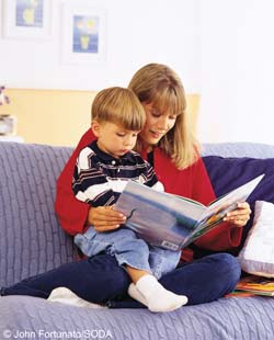 Childminder reading with child