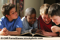 Young boys sharing a book