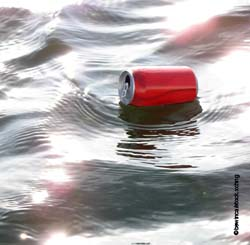Drinks can floating on water