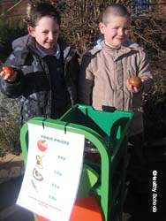 Two boys selling fruit