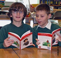 Two school boys reading