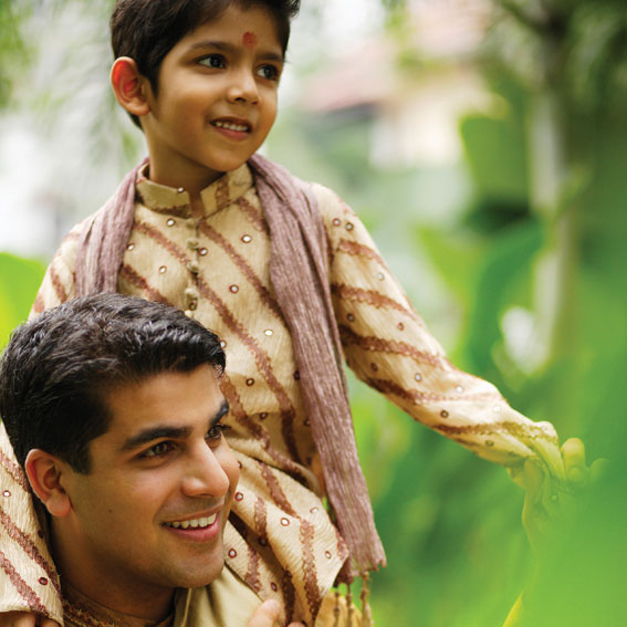 Boy and father celebrating Diwali