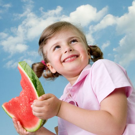 Girl with slice of watermelon