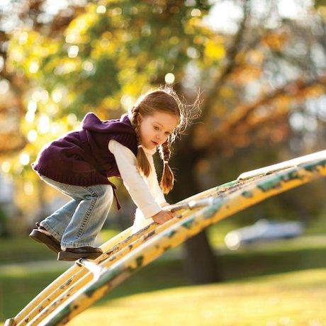 Girl on a climbing frame