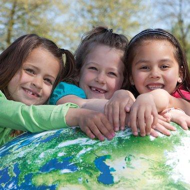 Children holding a globe