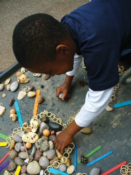 Child using found objects