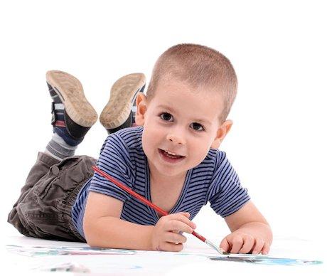 Little boy painting