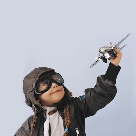 Girl playing with toy aeroplane