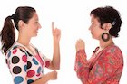 Two women speaking sign language