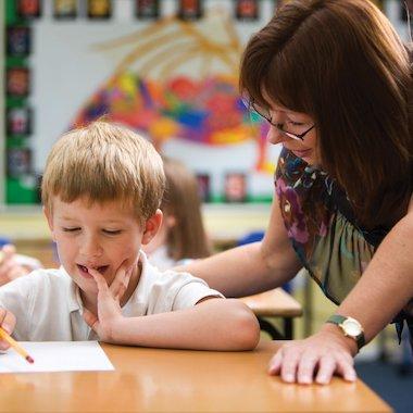 Teacher helping a child