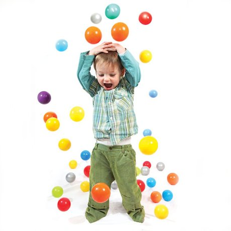 Boy with brightly coloured balls