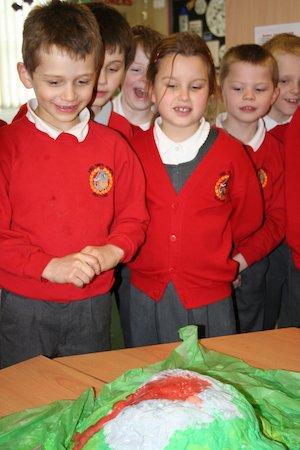 Children watching a handmade volcano