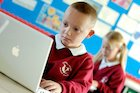 Children at Childwell Valley Primary School using ICT