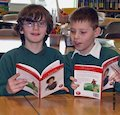 Two school boys reading