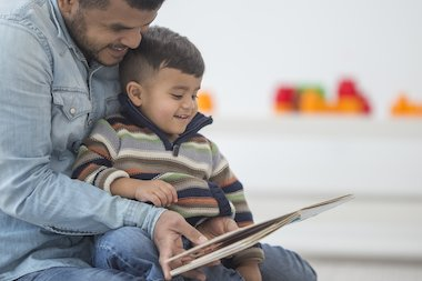 Man reading to a young boy
