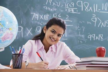 Teacher writing a report