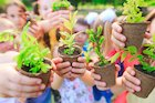 children holding plants
